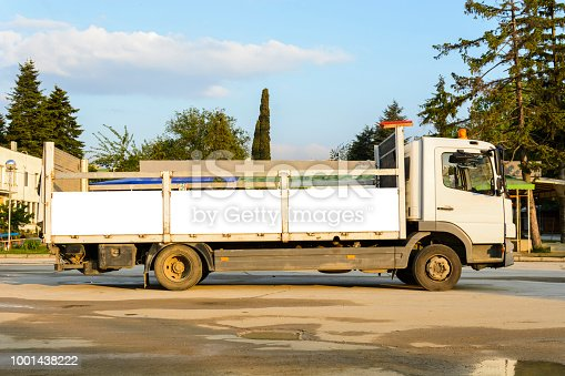 istock delivery truck with blank space for you advertising. 1001438222