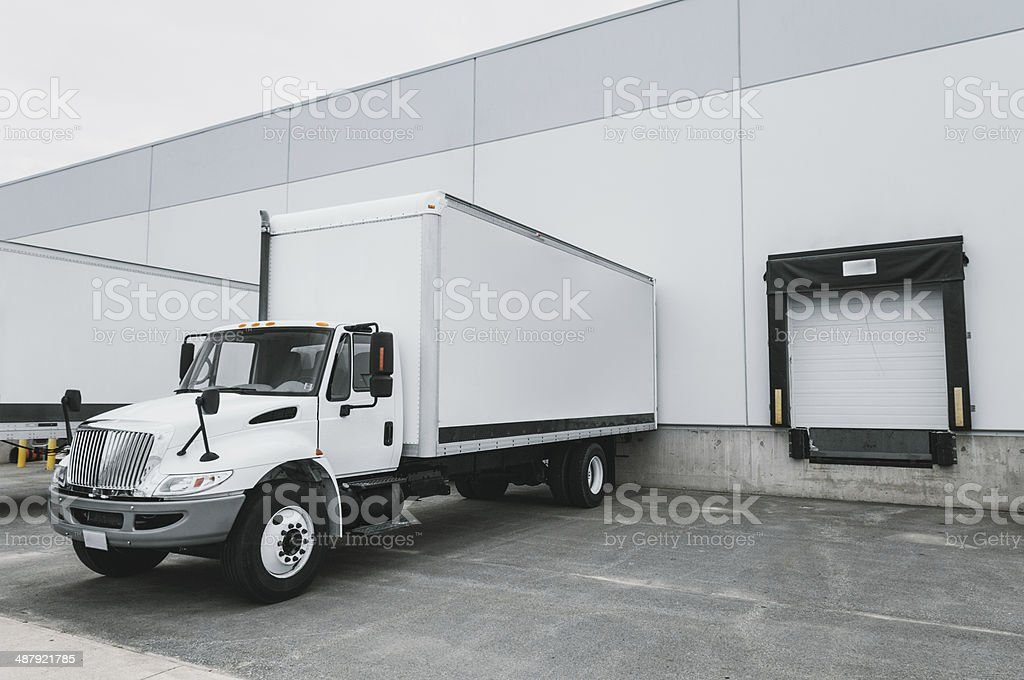 Delivery Trucks at Warehouse stock photo