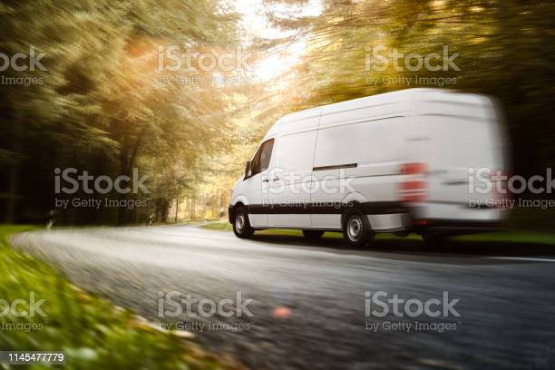Delivery van drives on a road picture id1145477779?b=1&k=6&m=1145477779&s=612x612&h=ps1vqw5ip234s5 y jj ewp1tg sty0i vm5lx6jdyy=