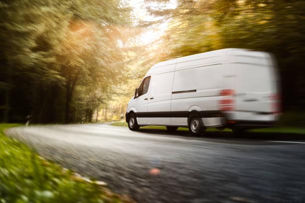 Delivery van drives on a road picture id1145477779?b=1&k=6&m=1145477779&s=612x612&w=0&h=knhp8v b9bvvea8yt41ywxl7ve2atkguhv6ocu98jgw=