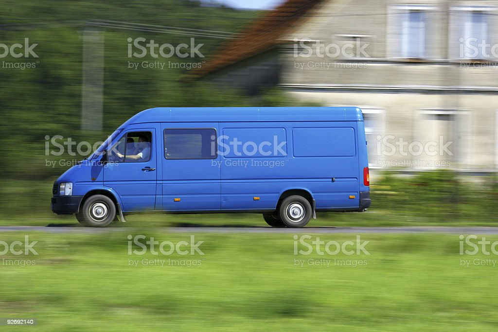 Delivery van driving stock photo