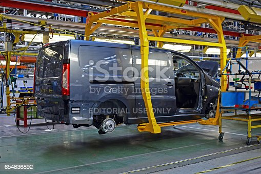 657996382 istock photo Delivery van in the car factory 654836892