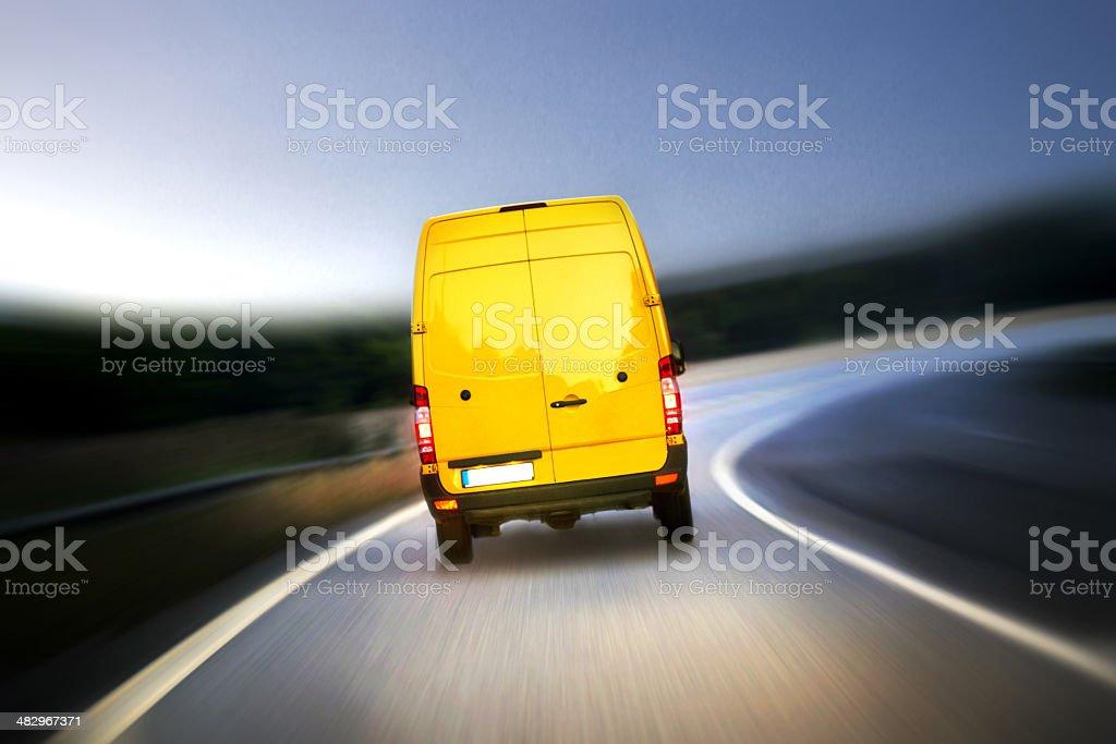 Delivery van on highway stock photo
