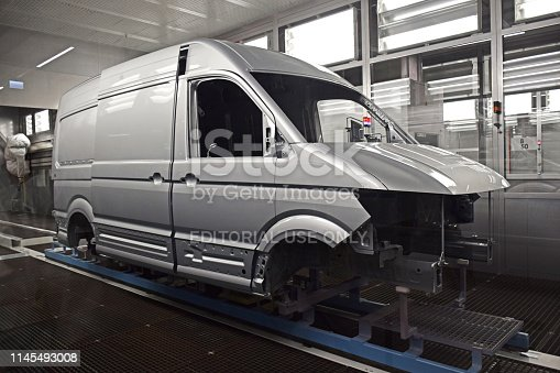 657996382 istock photo Delivery van vehicle on the production line 1145493008