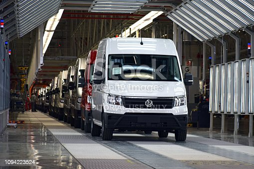 657996382 istock photo Delivery vans on the production line 1094223524