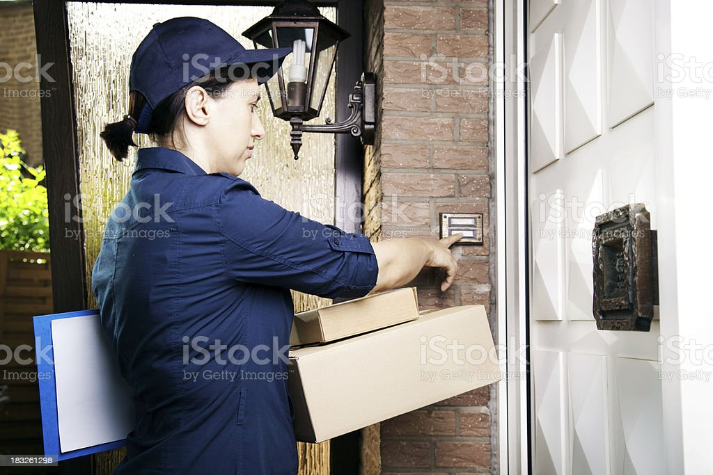 Delivery worker delivers packages stock photo
