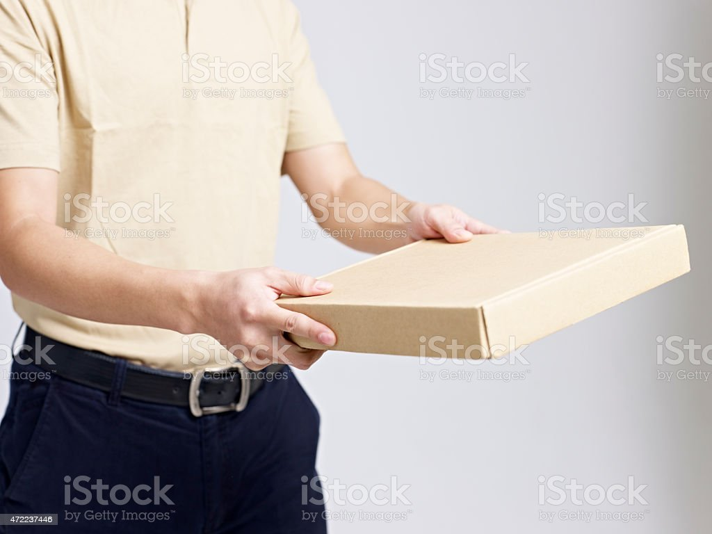 deliveryman delivering a package to customer stock photo