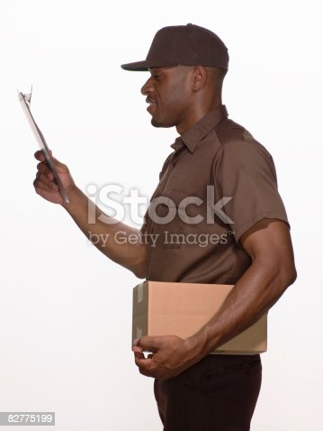 istock delivery-person with box and clipboard 82775199