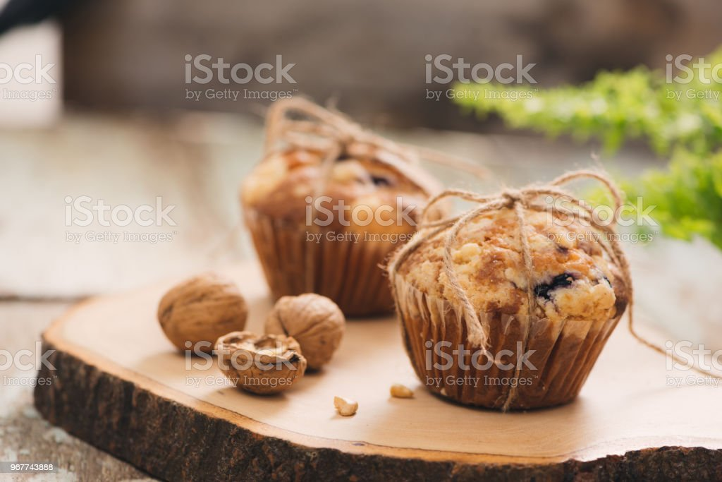 Dellicious homemade nut muffins on table. Sweet pastries stock photo