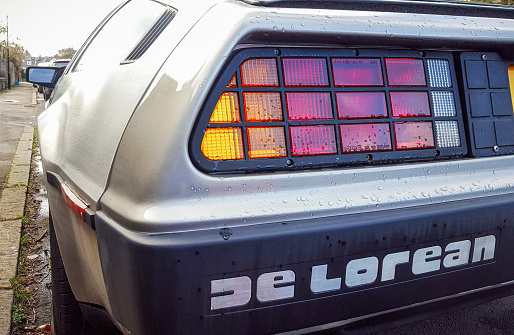 Edinburgh, UK - Close-up of the rear lights and branding of a DeLorean DMC-12 car, made by the DeLorean Motor Company in the early 1980s. The rare car was made famous by the 'Back To The Future' film trilogy.