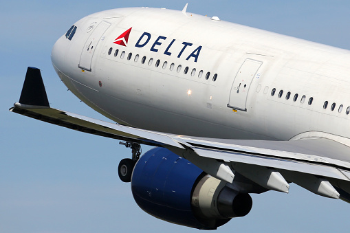 Amsterdam, Netherlands - April 21, 2015: A Delta Air Lines Airbus A330-300 with the registration N808NW takes off from Amsterdam Airport (AMS) in the Netherlands. Delta is one out of the three major American legacy carriers with its headquarters in Atlanta.