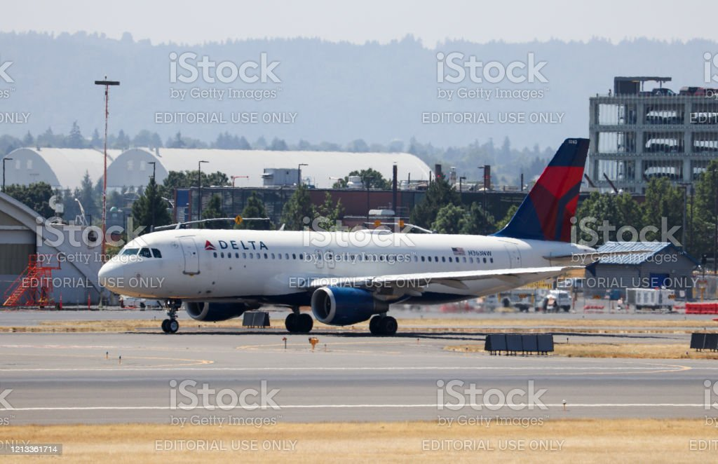 Delta Airlines Airbus A320 Taxiing To The End Of The Runway For Departure From Portland International Airport Stock Photo Download Image Now Istock