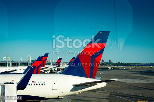 The delta Airlines taxi way and hard standing at New York JFK International Airport as seen from the subway approaching the airport.
