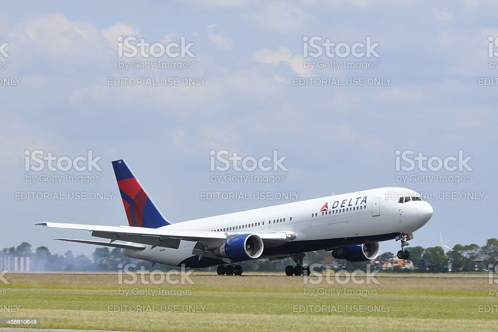 Delta airlines plane landing royalty-free stock photo