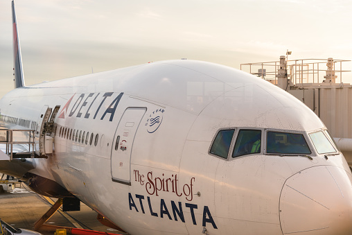 Atlanta, Georgia, United States - December 31, 2015 : Delta airplane parked at the International Airport of Atlanta . Image taken at dusk