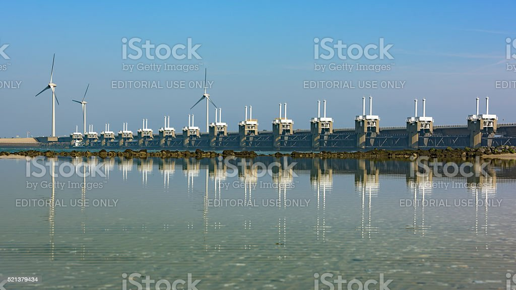 Delta works in Zeeland with reflection and blue sky stock photo