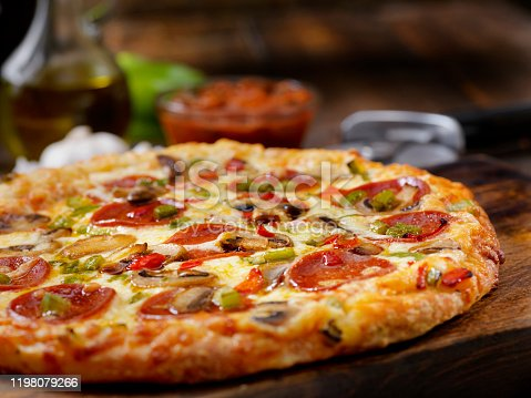 Deluxe Pizza with Pepperoni, Sausage, Mushrooms and Peppers