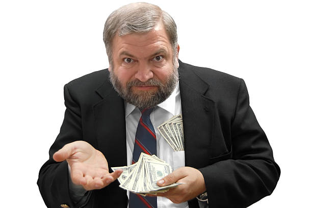 Demanding Payment This greedy businessman wants more money! miserly stock pictures, royalty-free photos & images