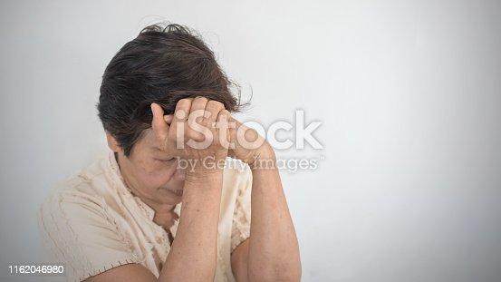 874789168istockphoto Dementia, Alzheimer's disease elderly senior patient (old aged women) with depression, mental stress illness, memory loss, schizophrenia symptom 1162046980