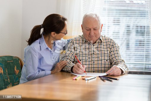 Dementia and Occupational Therapy - Home caregiver and senior adult man