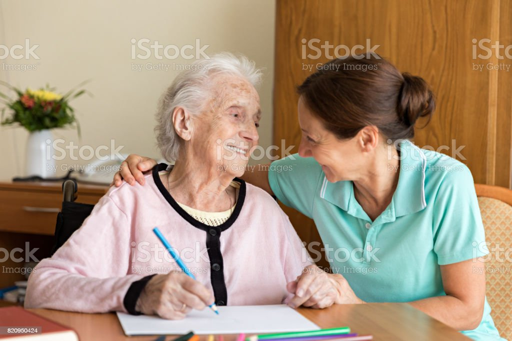 Dementia and Occupational Therapy - Home caregiver and senior adult...
