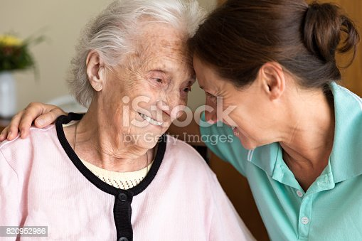 istock Dementia and Occupational Therapy - Home caregiver and senior adult woman 820952986