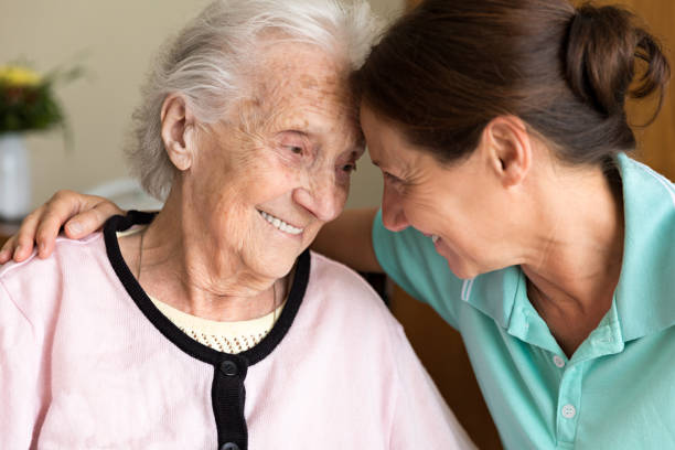 dementia and occupational therapy - home caregiver and senior adult woman - accudire foto e immagini stock