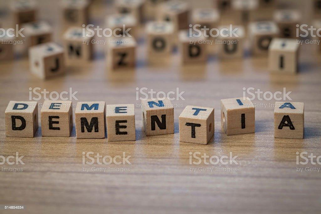 Dementia written in wooden cubes stock photo