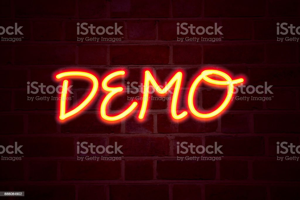Demo neon sign on brick wall background. Fluorescent Neon tube Sign on brickwork Business concept for Software Demonstration 3D rendered stock photo
