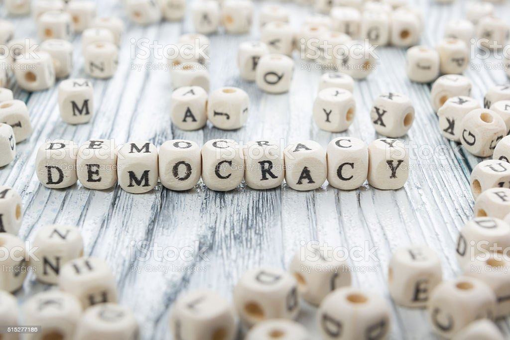 Democracy word written wood block. Wooden ABC stock photo