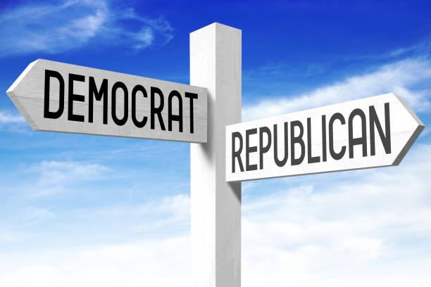 democrat, republican - wooden signpost - республиканская партия сша стоковые фото и изображения