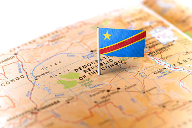 democratic republic of congo pinned on the map with flag - demokratische republik kongo stock-fotos und bilder