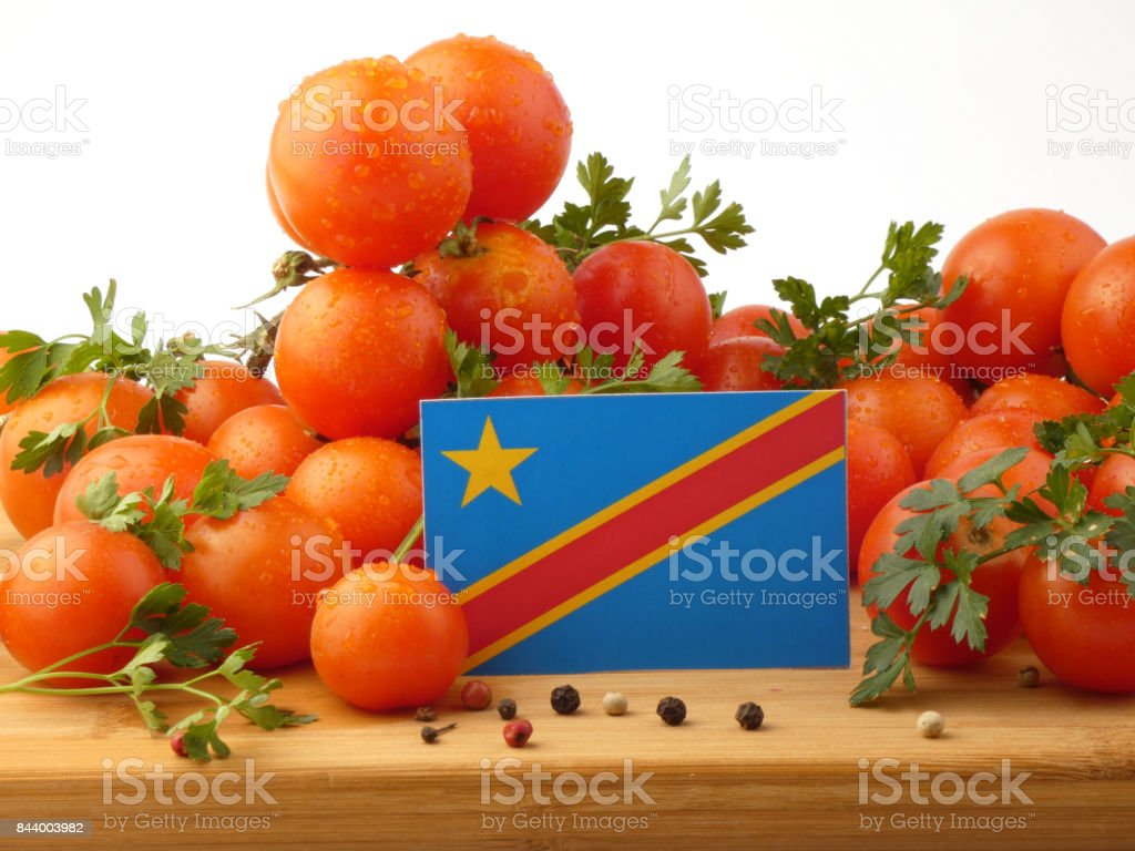 Democratic Republic of the Congo flag on a wooden panel with tomatoes isolated on a white background stock photo