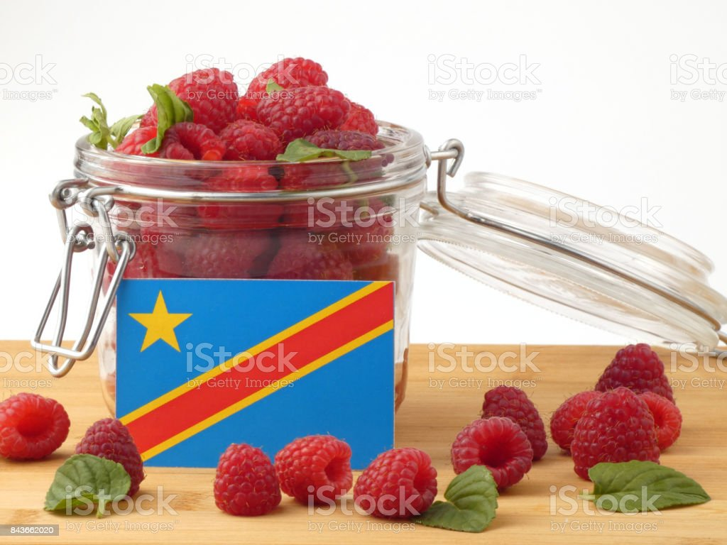 Democratic Republic of the Congo flag on a wooden plank with blueberries isolated on white stock photo