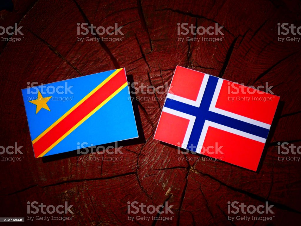 Democratic Republic of the Congo flag with Norwegian flag on a tree stump isolated stock photo