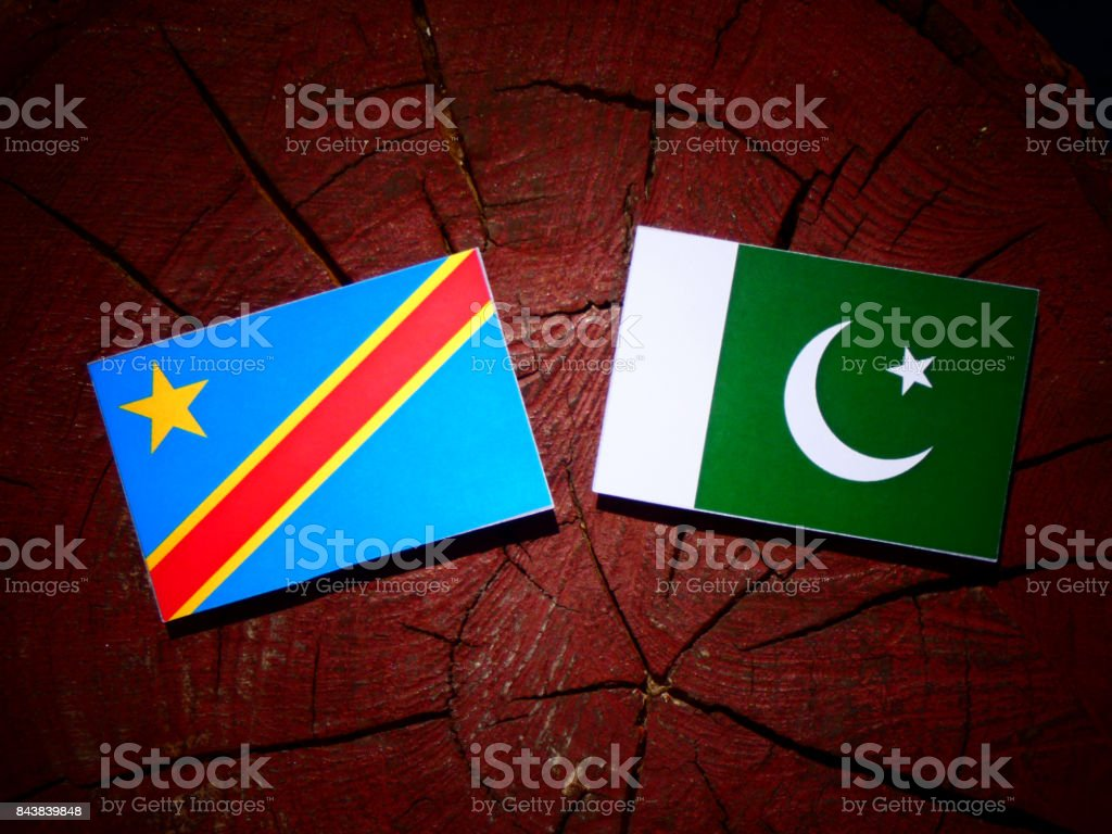 Democratic Republic of the Congo flag with Pakistan flag on a tree stump isolated stock photo