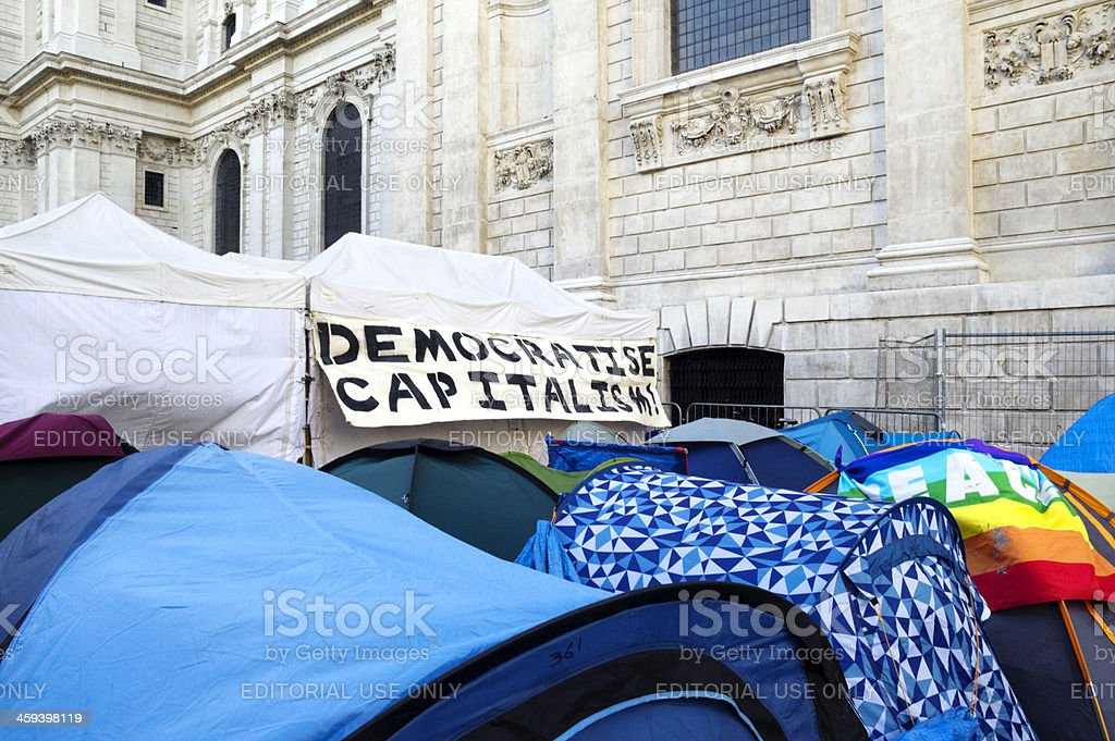 'Democratise Capitalism' banner on tent at 'Occupy London' royalty-free stock photo