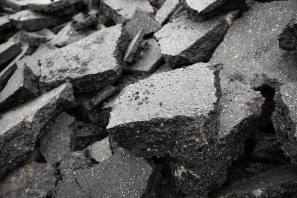 Demolished asphalt surface - large pieces on the pile stock photo