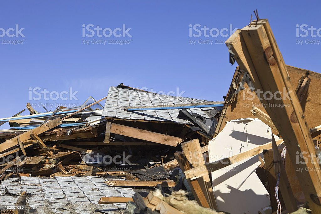 Demolished Home against a Clear Blue Sky royalty-free stock photo