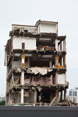 Demolished old house in a city background in China.