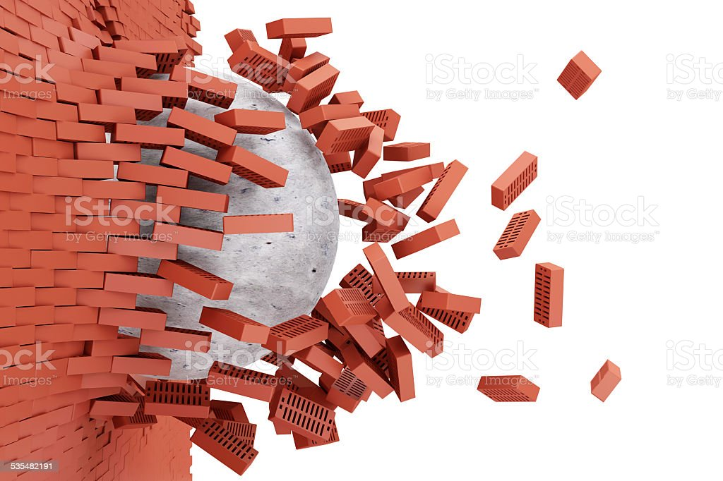 Demolished Red Brick Wall by Concrete Ball stock photo