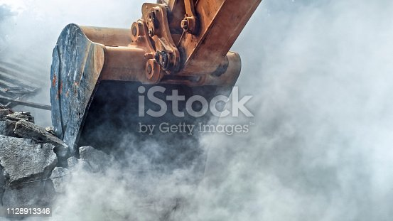 istock Demolishing building 1128913346