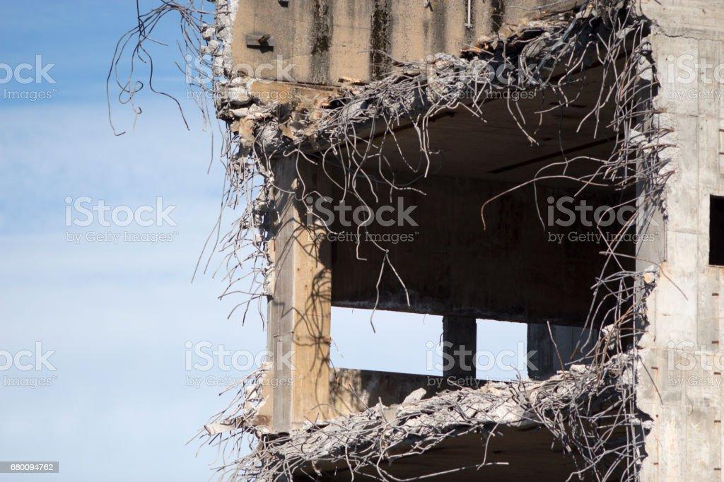 Demolishing concrete building. Rebars sticking out stock photo