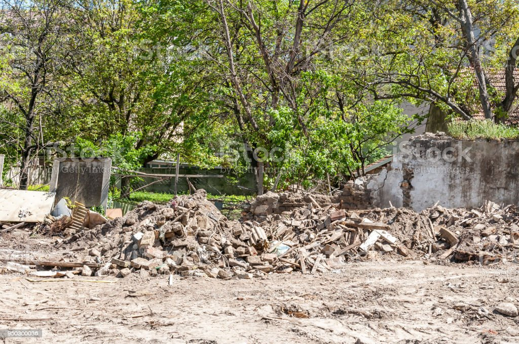 Demolition and destruction site bricks remains and leftovers of building material on the ground empty space stock photo