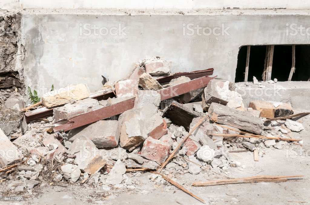 Demolition and destruction site bricks remains of building material on the ground by the foundation base stock photo