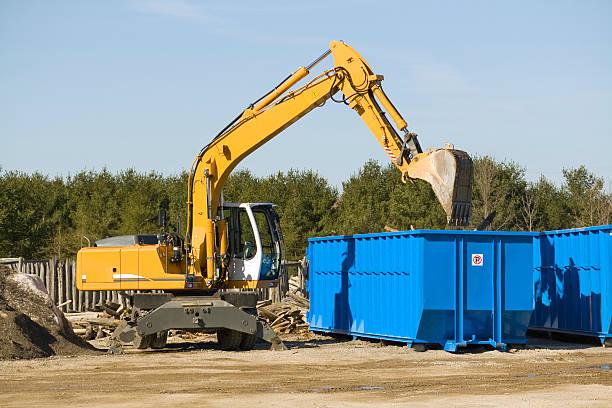 demolition bulldozer - garbage bin stock photos and pictures