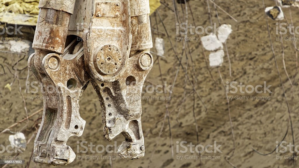 Demolition concrete pulverizer jaws which looks like a mechanical dragon stock photo