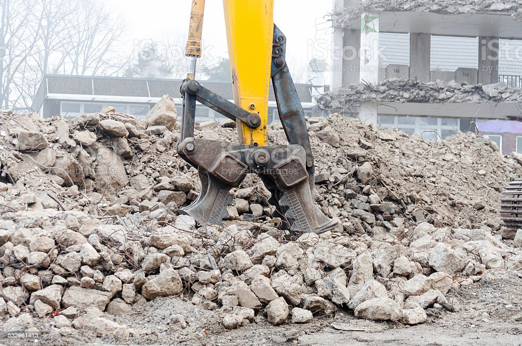 Demolition excavator in action stock photo
