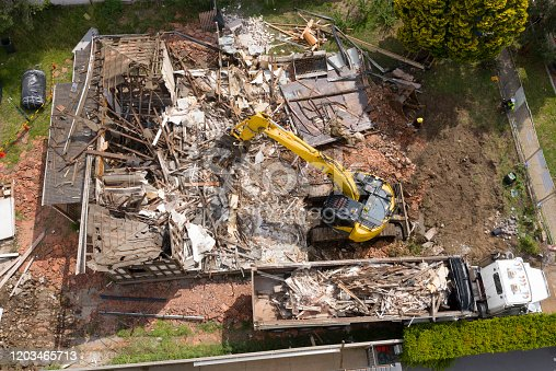 istock demolition  of a house. 1203465713