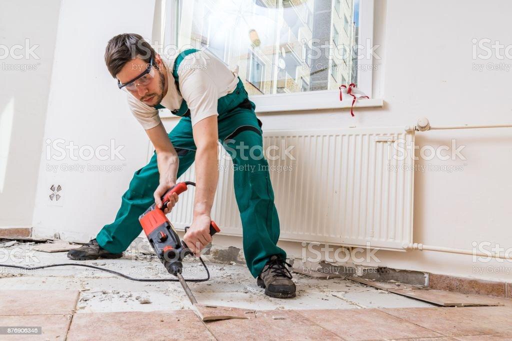 Demolition Of Old Tiles With Jackhammer Renovation Of Old Floor